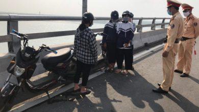 Xử phạt hàng chục trường hợp dừng xe trên cầu Cửa Hội để... check in 1